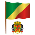 Congo republic wavy flag of the and coat of arms against white background vector art illustration image contains transparency Stock Photo