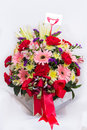 Congratulate vase red flowers in the for Royalty Free Stock Images