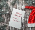Congratulation in rustic style with a booklet where you can leave a message for Santa. Royalty Free Stock Photo
