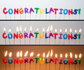 Congratulations candles three different views of some cake unlit lit light background and lit darker background cut and paste as Stock Images