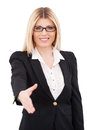 Congratulations confident mature businesswoman stretching out hand for shaking and smiling while standing isolated on white Royalty Free Stock Images