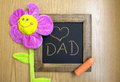 Congratulations father a piece of chalk and toy flower Stock Image
