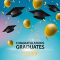 Congratulations Graduates 2019, caps, balloons and confetti on a blue sky background. Caps thrown up. Invitation card