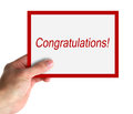 Congratulations hand hold a big card with text isolated on white Stock Photos