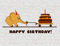 Congratulations to the happy birthday for a child. Graffiti on a white brick wall. Cartoon elephant calf with cake and one candle