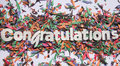 Congratulations white sign on confetti background Stock Photography
