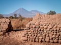 Conical mountain through wall landscape a shot a gap in a san pedro chile Stock Image