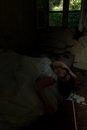 Conjugal crime scene creepy bride lying in creepy devastated room Royalty Free Stock Images