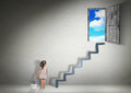Conquer concept, child girl draws stairs for the exit Royalty Free Stock Photo