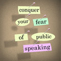Conquer your fear of public speaking bulletin board overcome sta words on papers pinned to a advice to stage fright when giving a Royalty Free Stock Photo