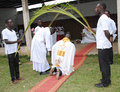 Consecration of a priest admire this beautiful image an african in full ceremonial for his ten years priesthood with his Royalty Free Stock Images