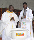 Consecration of a priest admire this beautiful image an african in full ceremonial for his ten years priesthood with his Stock Photography