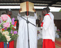 Consecration of a priest admire this beautiful image an african in full ceremonial for his ten years priesthood with his Stock Photo