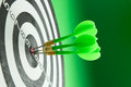 Consistency three green darts pinned right on the center of dartboard Royalty Free Stock Images