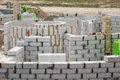 Constraction workers building a roundhouse with aerated autoclaved concrete blocks. Royalty Free Stock Photo