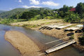 The construction of bamboo rafts on the river bank Stock Photography