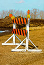 A construction barricade on a gravel road Royalty Free Stock Photo
