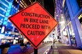 Construction in bike lane proceed with caution sig Stock Photo