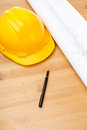 Construction blue print and safety helmet on the table Royalty Free Stock Image