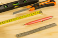 Construction bubble spirit level tool cutter pen and ruler on wood table Stock Images