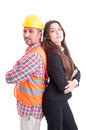 Construction builder and business woman standing back to back women confident as successful partnership teamwork concept isolated Royalty Free Stock Image