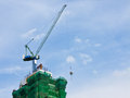 Construction building multiple layers high crane is lifting cement tanks move Royalty Free Stock Photography
