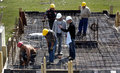 Construction building under with workers Stock Photo