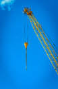 Construction crane against a blue sky background Royalty Free Stock Image