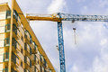 Construction crane with building on the site Stock Photo