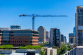 Construction Crane in downtown Austin Texas building a new Highrise on a clear day Royalty Free Stock Photo