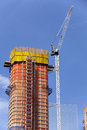 Construction - Crane and new highrise apartment building Royalty Free Stock Photo