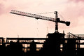 Construction crane silhouettes and red cloudy sky Royalty Free Stock Image