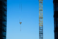 Construction crane on the sky background among buildings Royalty Free Stock Photo