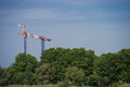 Construction crane towering above the trees, city and nature Royalty Free Stock Photo