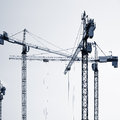 Construction cranes silhouettes. Royalty Free Stock Photo