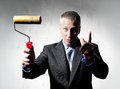 Construction director with paint roller Royalty Free Stock Images
