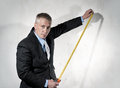 Construction director with tape measure Royalty Free Stock Image