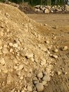 Construction: earth pile and excavated rocks Royalty Free Stock Photo