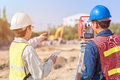 Construction engineer and foreman worker checking site Royalty Free Stock Photo