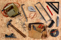Construction equipment on plywood overhead view of and tools laid out a sheet of items include hammer nails square block plane Royalty Free Stock Image
