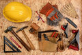 Construction equipment on plywood overhead view of and tools laid out a sheet of items include hard hat gloves hammer square block Stock Photo
