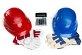 Construction financing a hard hat gloves and calculator on white background Royalty Free Stock Images