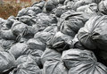 Construction garbage bags in dumpster metal Royalty Free Stock Photography