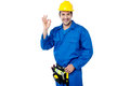 Construction guy gesturing okay sign keep up the great work excellent team work Royalty Free Stock Image