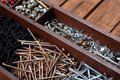 Construction hardware a tray of miscellaneous screws nails and other fasteners Royalty Free Stock Photos