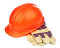 A construction hat and heavy duty gloves Royalty Free Stock Photo