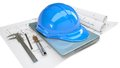 Construction helmet and laptop in the drawings Stock Image