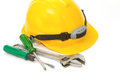 Construction Helmet with screw driver and wrench Stock Image