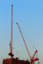 The construction of high buildings in the city cranes after work evening sky as background Royalty Free Stock Images