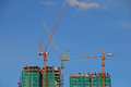 Construction of high rise building with three tower cranes Stock Photos